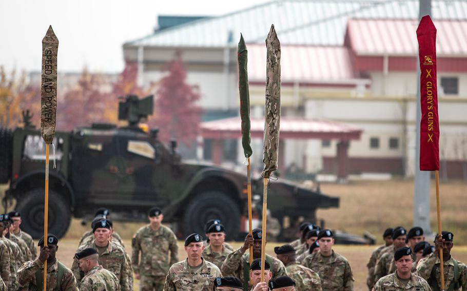 The 1st Armored Brigade, 3rd Infantry Division colors are cased during a transfer of authority ceremony at Camp Humphreys, South Korea, Monday, Oct. 22, 2018.