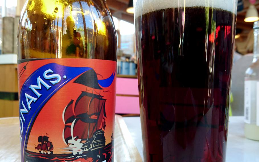 A pint of Adnams Broadside from the Adnams Southwold Store and Cafe in Southwold, England, Saturday, October 20, 2018. Broadside is a strong ale that commemorates when the English fought the Dutch in 1672 off the Southwold coast in the Battle of Sole Bay.