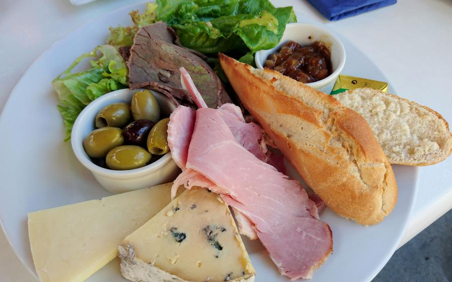 A ploughman's lunch from the Adnams Southwold Store and Cafe in Southwold, England, Saturday, October 20, 2018. This traditional British meal often consists of meat, cheese, bread and beer.