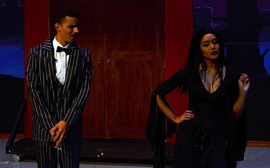 """Servicemembers Shaun Canty and Jessica Turney star as Gomez and Morticia during a rehearsal for """"The Addams Family"""" musical comedy at Yokota Air Base, Japan, Tuesday, Oct. 23, 2018."""