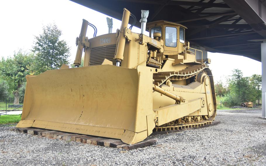 The Acco bulldozer, reportedly the largest such vehicle ever produced, sits at an underpass on the grounds of the Bejaflor gardening business in Portogruaro, Italy.