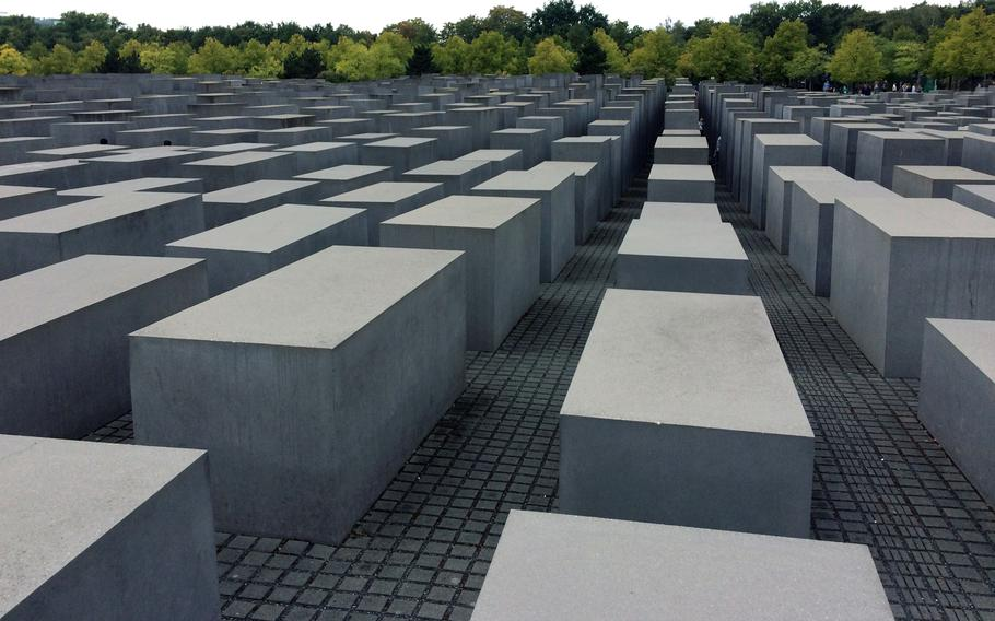 The Field of Stelae at the Memorial to the Murdered Jews of Europe in Berlin, Germany. The 2,711 stelae are 7 feet, 10 inches long and 3 feet 1 inch wide, with heights ranging from about eight inches to over 15 feet.