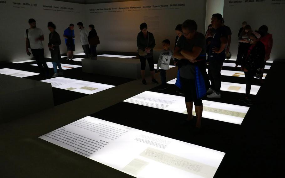 Visitors to the Memorial to the Murdered Jews of Europe information center read excerpts from diaries and letters written by victims of the Holocaust in the ''Room of Dimensions.''
