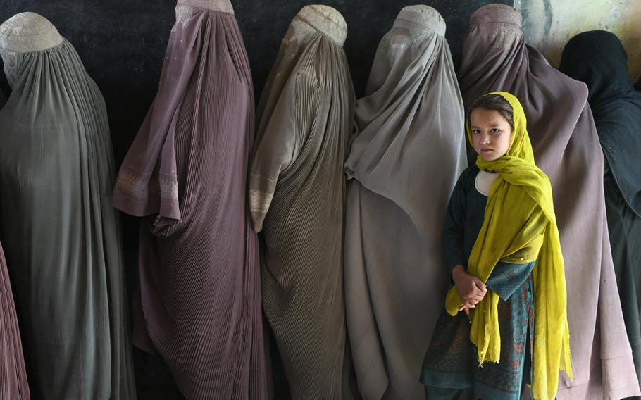 Women wait in line to vote at a polling center in Kandahar, Afghanistan, on Saturday, Oct. 27, 2018.