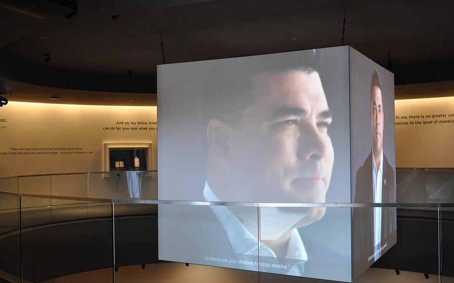 An interview with Jason Dominguez, a former Marine Corps sergeant, plays on large screens in the center of the National Veterans Memorial and Museum on Oct. 26. The facility opened Oct. 27 in Columbus, Ohio.