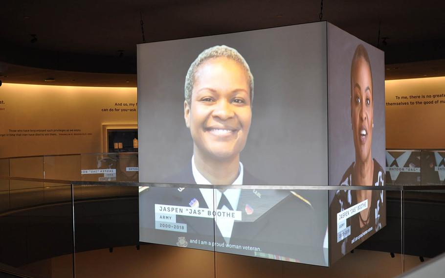 An interview with Army veteran Jaspen Boothe plays on large screens in the center of the National Veterans Memorial and Museum on Oct. 26. The facility opened Oct. 27 in Columbus, Ohio.