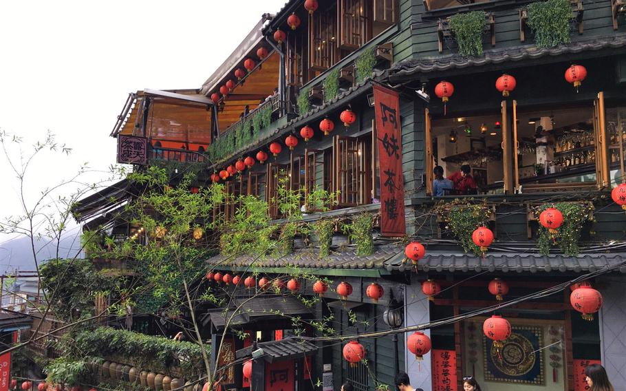 Jiufen is a picturesque old town located on a hill overlooking the ocean with narrow staircases winding throughout the village.