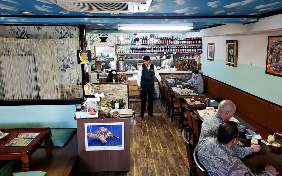 Kharel Krishna, owner of Dana Chula Family Indian Restaurant near Yokota Air Base in western Tokyo, waits on customers November 8, 2018 before the lunch rush begins.