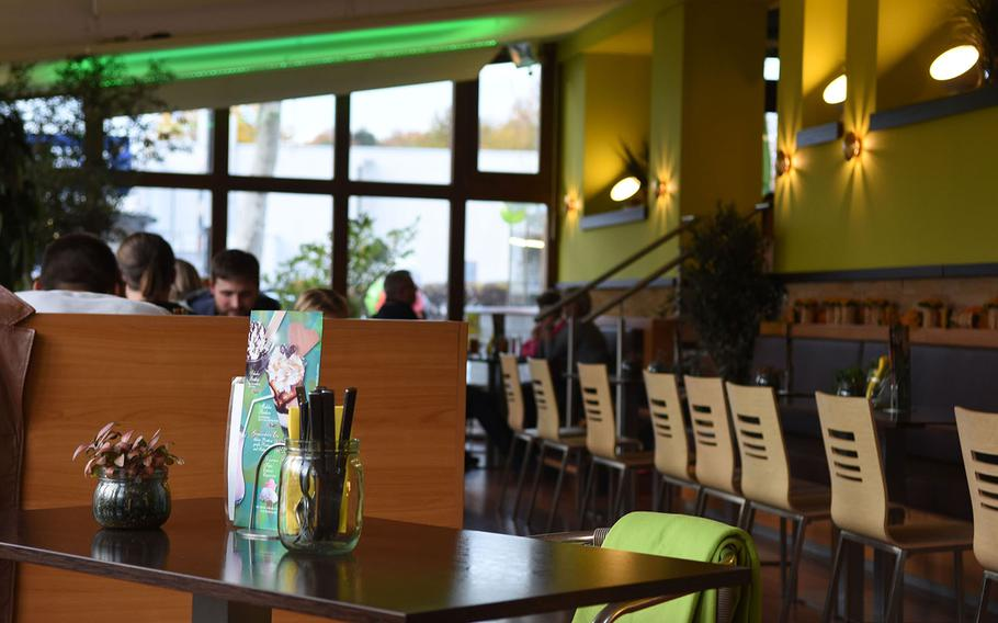 The Cheesecake No. 122 in Kaiserslautern, Germany, has a pleasant, cheerful ambience, with bright colors inside the restaurant and plenty of natural lighting.