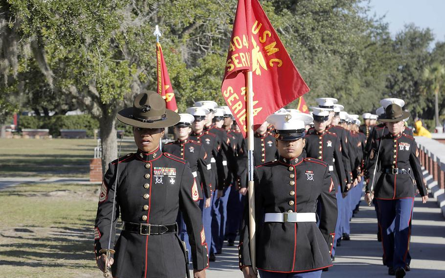 Drill instructors and Marines with November Company, 4th Recruit Training Battalion march before their graduation ceremony at Marine Corps Recruit Depot Parris Island, S.C., Friday Nov. 16, 2018.