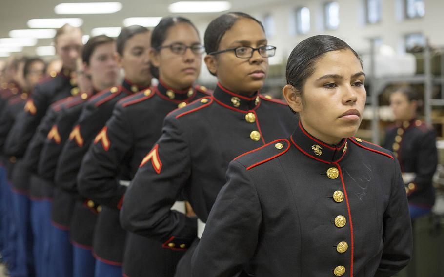 Marines with November Company, 4th Recruit Training Battalion wait to have their uniforms examined by fitters at Marine Corps Recruit Depot Parris Island, S.C., Nov. 9, 2018.