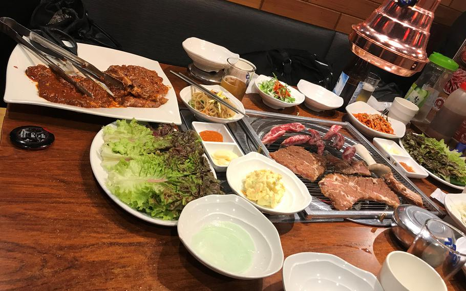 """Hoejen Hwa Hwa's """"Special Set"""" can easily feed a family of four and includes three different types of beef ribs and a mildly spiced chicken for 50,000 won (or about $45)."""