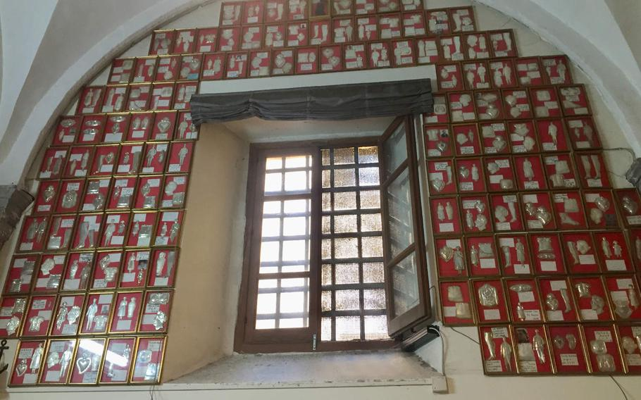 Within the church's Chapel of the Visitation are hundreds of testimonials from people claiming to have been healed by St. Guiseppe Moscati. The body parts that were healed are cast in silver on the red plaques.