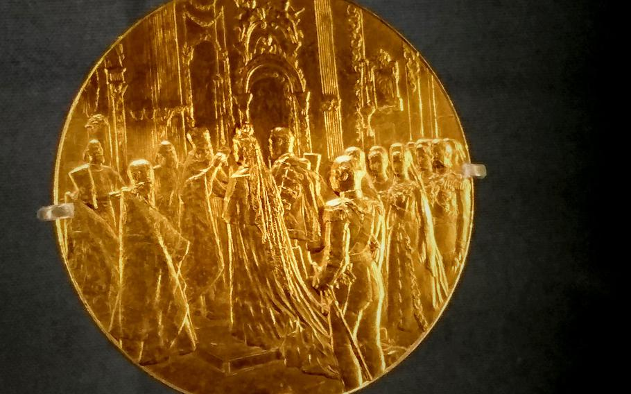 A medal commemorating the marriage of Russian Emperor Nicholas II and British Princess Alix of Hesse displayed in the Queen's Gallery at Buckingham Palace, London, on Dec. 15. Great Britain's Queen Victoria shared five mutual Romanov great-grandchildren with Russian Tsar Alexander II.