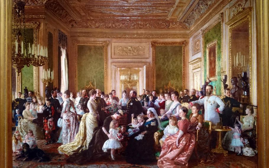 A painting of Queen Victoria's family in 1887 displayed Dec. 15 in the Queen's Gallery at Buckingham Palace, London. The setting for the painting is the Green Drawing Room inside Windsor Castle.