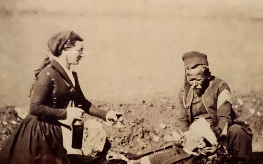 An albumen print taken by photographer Roger Fenton taken during the Crimean War displayed in the Queen?s Gallery at Buckingham Palace, London, Saturday, Dec. 15, 2018. Women were attached to French regiments to supply the troops with food and drink beyond the standard rations.