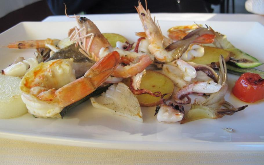A popular dish at Massimo Gusto in Vicenza balances fish, seafood, vegetables and white polenta.