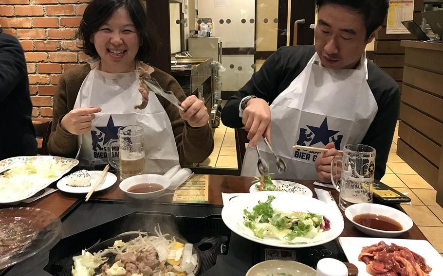"""Sapporo Beer Garden serves the """"Genghis Khan,"""" a traditional Hokkaido barbecue of fresh lamb and vegetables cooked on your table in a metal skillet."""