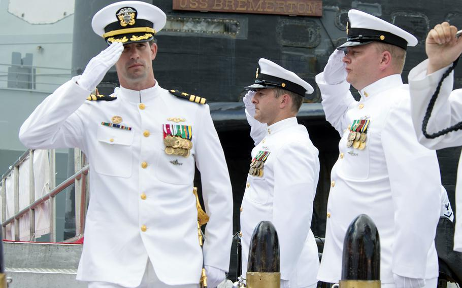 Capt. Travis Zettel, then-commander of the fast-attack submarine USS Bremerton, salutes sideboys at Joint Base Pearl Harbor-Hickam, Hawaii, Aug. 5, 2016.