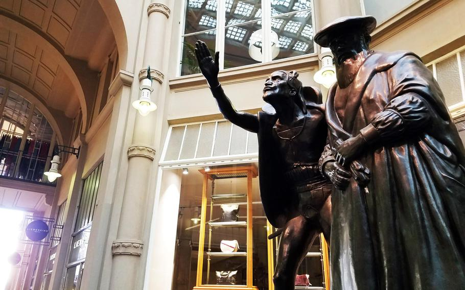 """The Faust and Mephisto statue from Johann von Goethe's famous play """"Faust,"""" outside the Auerbachs Keller in Leipzig, Germany."""