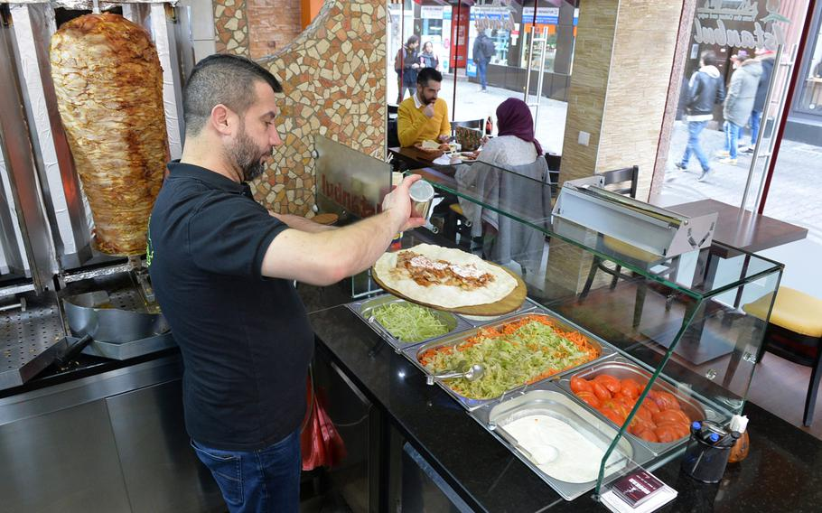 A cook at Istanbul Kebap Haus in Kaiserslautern prepares Lahmacun, flat bread covered with spiced ground meat. The centrally located restaurant has some of the best authentic Turkish food in Kaiserslautern.