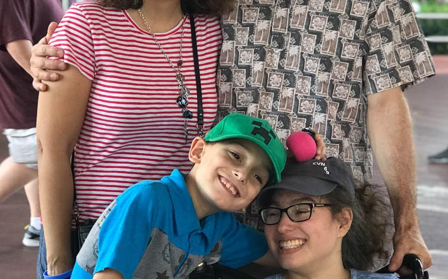 Michelle Norman and husband Navy Capt. Cassidy Norman pose with their children Chase, 9, and Marisa, 15, during a  trip to Disney World in December 2018. The  Normans are fighting the Virginia Beach school district to keep Marisa, who is severely disabled, in a private school.