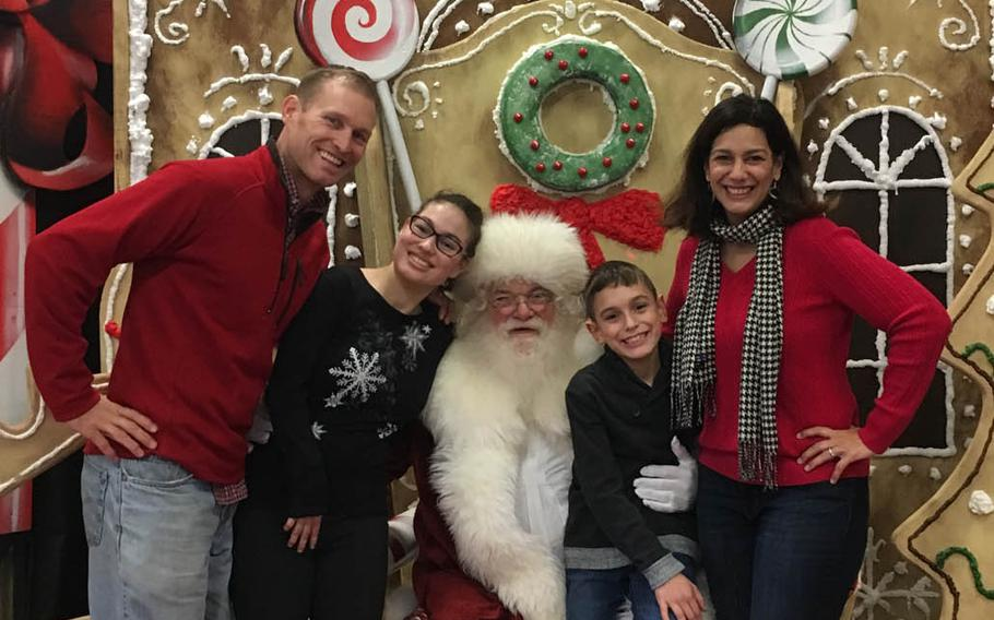 Navy Capt. Cassidy Norman, left, with his daughter Marisa, 15, son Chase, 9 and wife Michelle, pose with Santa near home in Virginia Beach in December 2018. The  Normans are fighting the school district to keep Marisa, who is severely disabled, in a private school.