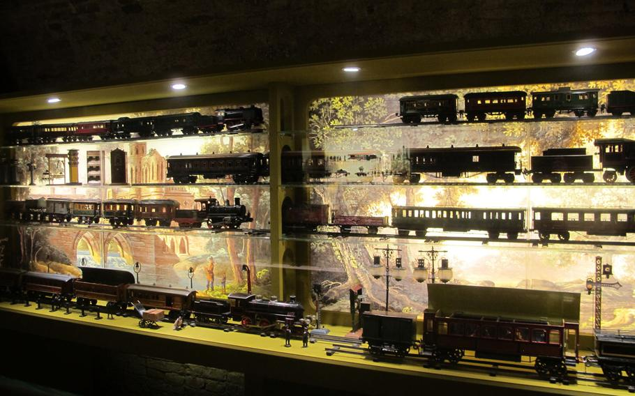 A roomful of toy trains, all in perfect working order and condition, is artfully lit. The trains a part of a massive collection of antique toys at the Palazzo Chiericati museum in Vicenza.