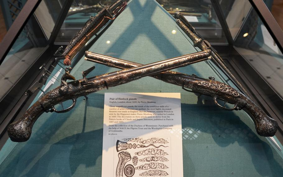 A pair of English flintlock pistols on display in the Hunting gallery at the Leeds Royal Armouries Museum in Leeds, England. They were designed in a French style by Huguenot maker Pierre Monlong, who moved to London in 1684.