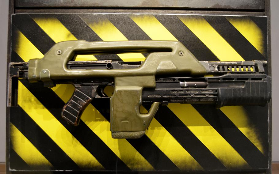 """An Armat M41A Pulse Rifle on display in the Self-Defense gallery at the Leeds Royal Armouries Museum in Leeds, England. The iconic sci-fi weapon was designed by director James Cameron for his classic 1986 film """"Aliens."""""""