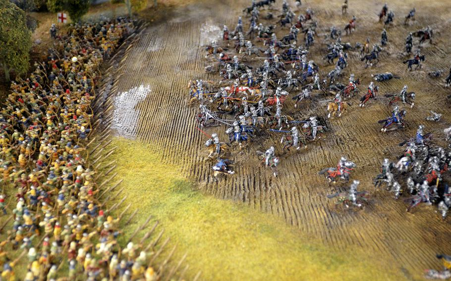 A scaled model of the decisive Battle of Agincourt in the War gallery at the Leeds Royal Armouries Museum in Leeds, England. The English and Welsh victory against an overwhelming force of French troops in 1415 essentially ended the Hundred Years War.