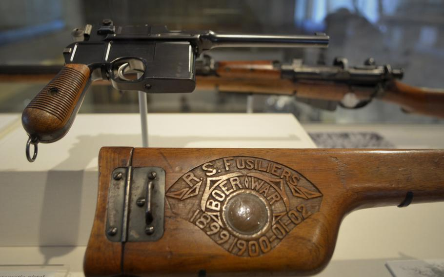 """A German Mauser C96 """"Broomhandle"""" from about 1899 on display in the War gallery at the Leeds Royal Armouries Museum in Leeds, England. The automatic pistol had a magazine capacity of 10 rounds and a range of more than 500 meters."""