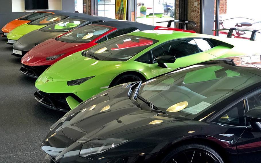 A row of Lamborghinis line the showroom floor at Klassikstadt in Frankfurt, Germany.