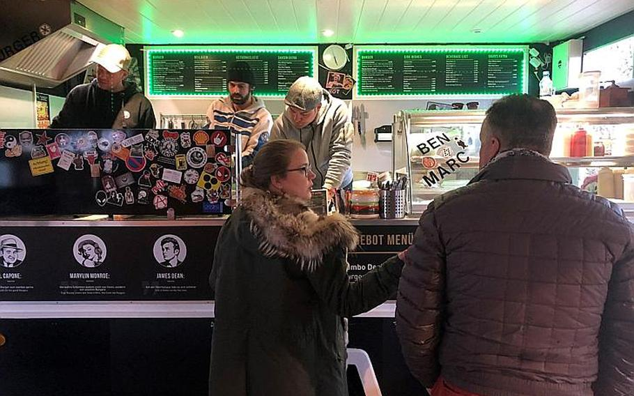 Customers at the Graveyard Burger Guys food truck order their food March 12. Graveyard Burger offers a simple, but customizable, menu with many toppings and side dish options.