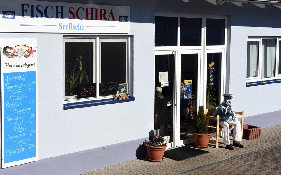 Fisch Schira in Kaiserslautern, Germany, posts its daily menu outside its entrance. Hint: they're serving fish.