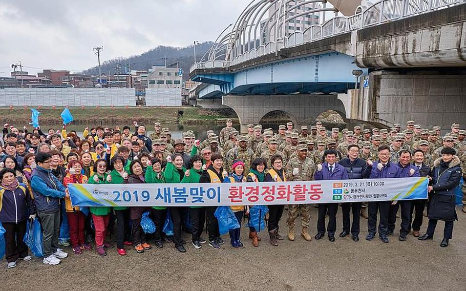 U.S. soldiers from Camp Casey and volunteers at the Shincheon River clean up in Dongducheon, South Korea, Thursday, March 21, 2019.