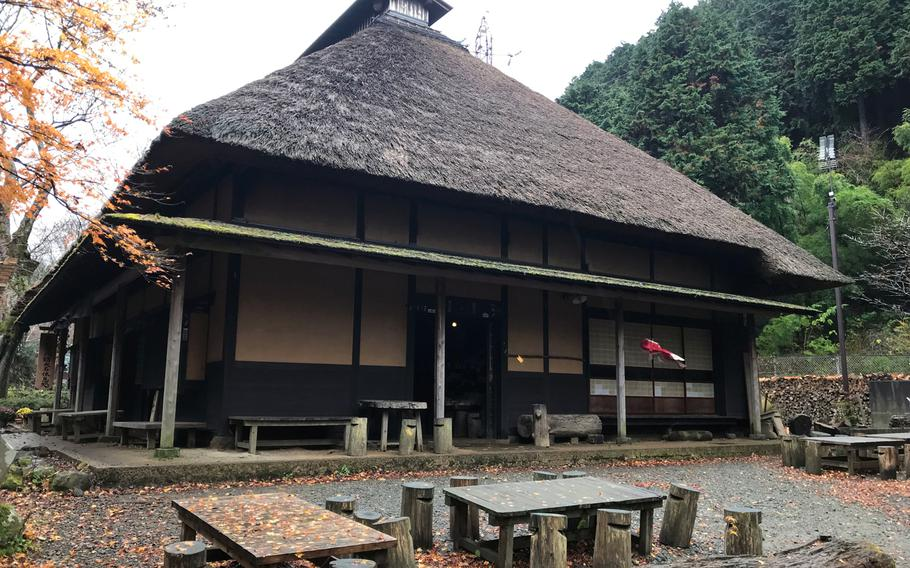 Amasake-chaya is housed inside a traditional Japanese-style building, complete with a thatched roof.