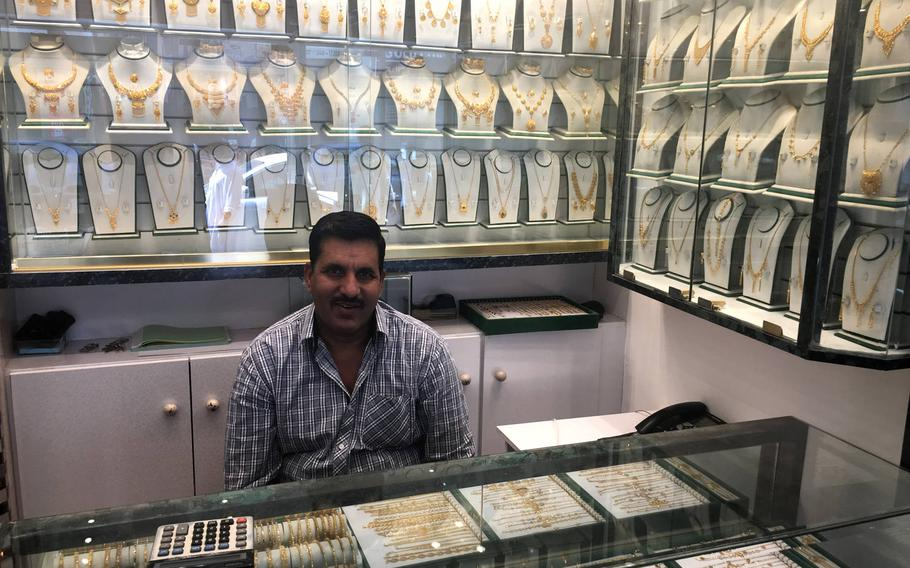 A shop owner poses for a photo inside his jewelry store in Qudaibiya, Bahrain on March 29, 2019.