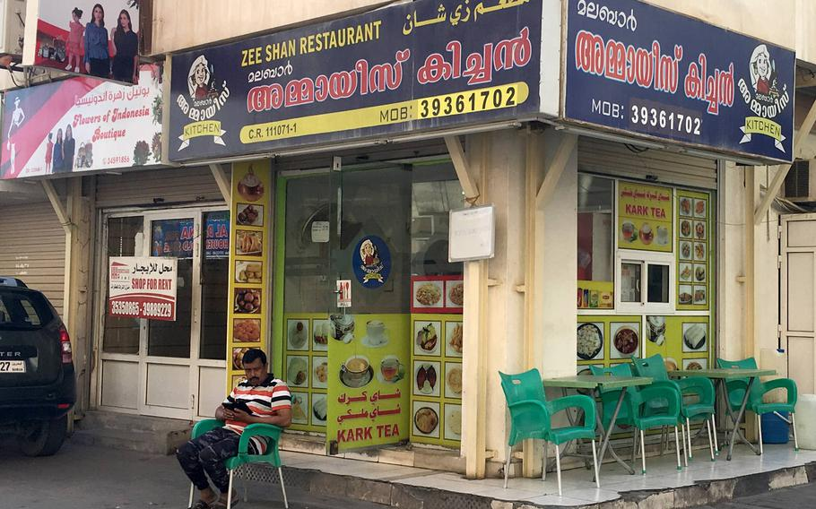 A shop owner sits outside an Indian restaurant in Qudaibiya, Bahrain on March 29, 2019.