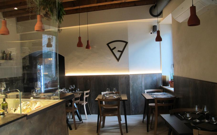 The simple interior of Fattore F restaurant in Vicenza, Italy, reflects its emphasis on natural, locally sourced products.