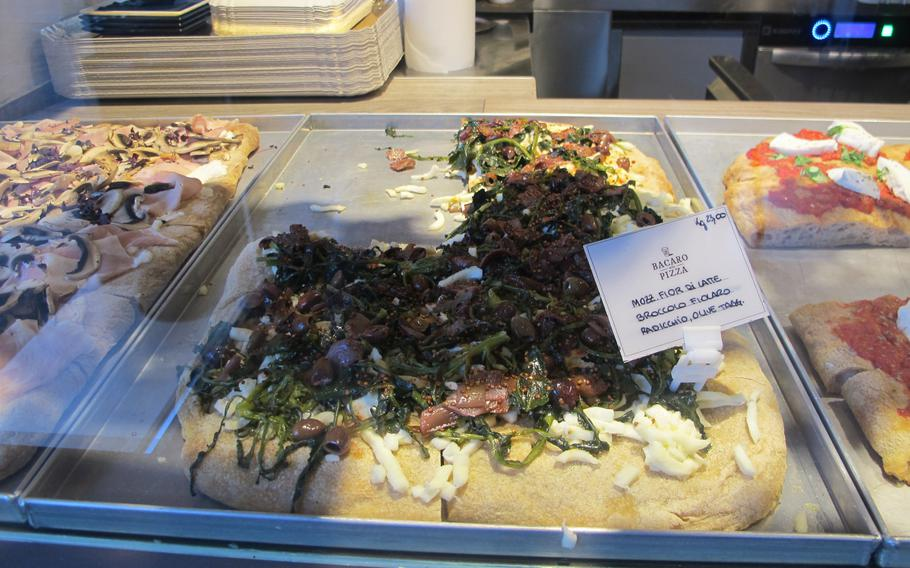 Fattore F in Vicenza, Italy, sells pizza to go priced by weight in addition to 16 pizzas on the menu. Pictured is pizza with mozzarella, radicchio, olives and broccoli fiolaro, a locally-grown type of broccoli.