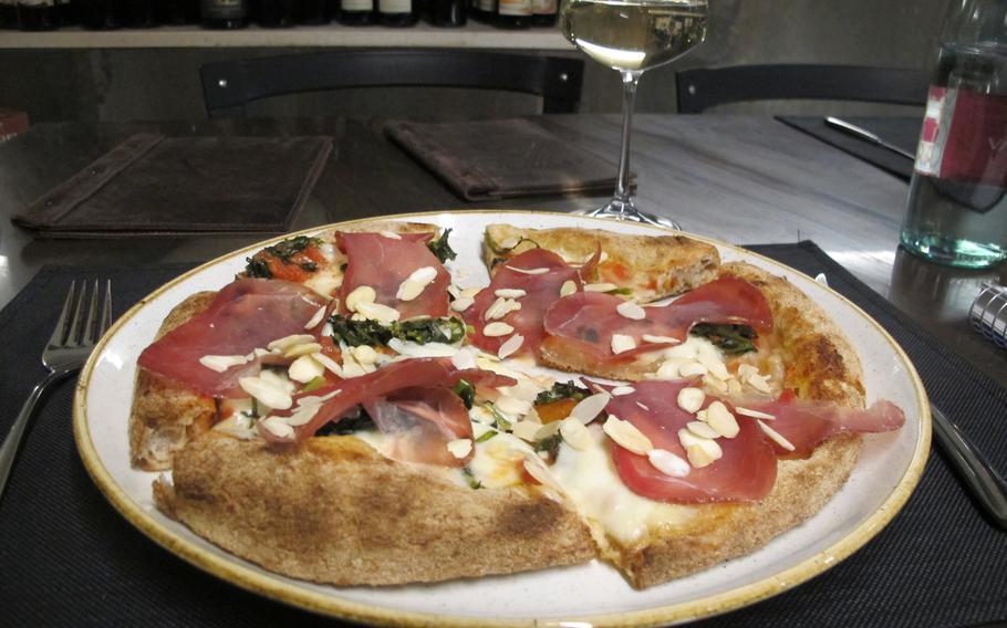 Wild boar pizza at Fattore F in Vicenza, Italy, also features mozzarella, kale and sliced almonds.