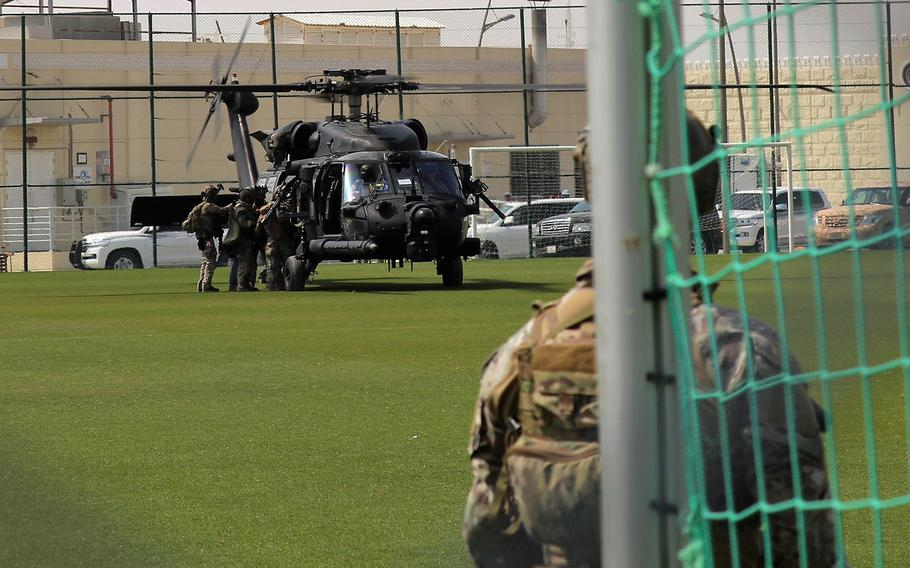 Members of a United States Army Special Forces team assigned to 10th Special Forces Group (Airborne) finish loading a MH-60 helicopter from the 160th Special Operations Aviation Regiment during an Invincible Sentry 2019 training scenario near the Abdullah bin Khalifa Stadium in Doha, Qatar, March 22. IS 19 is a combined exercise used by U.S. Central Command to validate its subordinate unit?s abilities to respond to crises in the region.