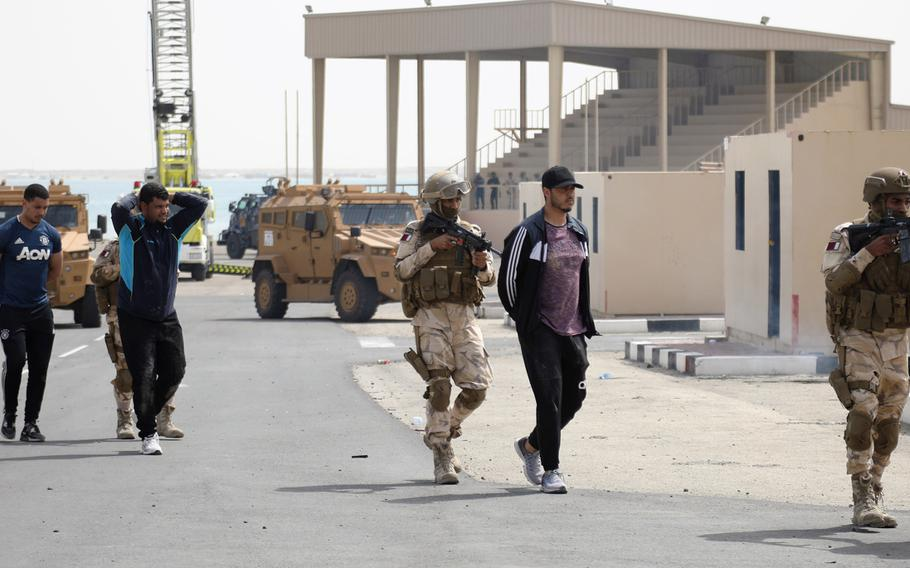Qatar Joint Special Forces soldiers move detaineesduring a simulated raid on a terrorist network on Sunday, March 24, 2019, as part of the weeklong exercise Invincible Sentry 2019. The exercise was aimed at sharpening the ability of the Qatari forces to work with their U.S. counterparts.   U.S. Army photo