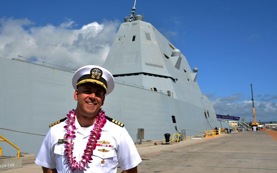 Capt. Andrew Carlson, commander of the USS Zumwalt, by his ship after arriving at Joint Base Pearl Harbor-Hickam, Hawaii, Tuesday, April 2, 2019.