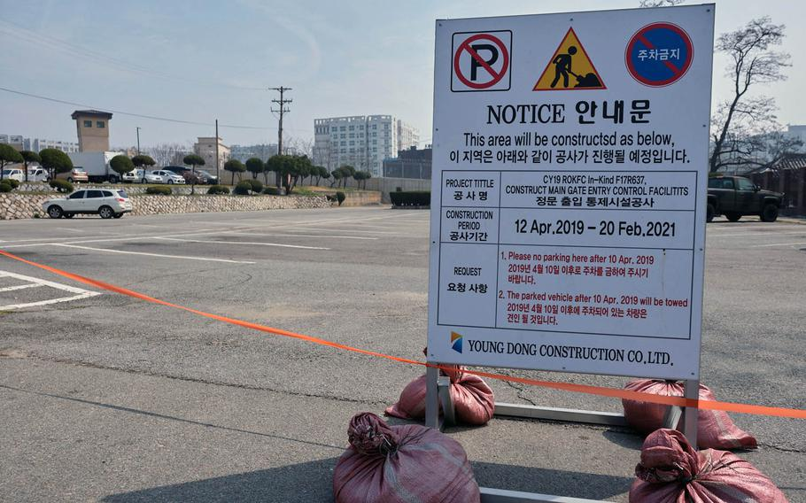 A sign and orange tape alert drivers to coming renovations at the main gate at Osan Air Base, South Korea, on Thursday, April 11, 2019.