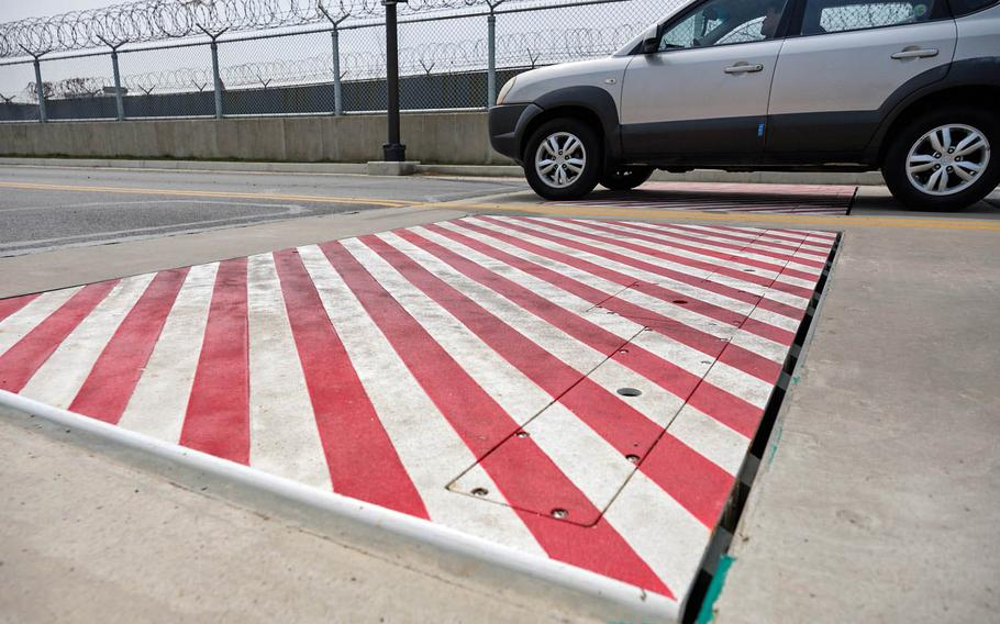 The same type of barrier seen here at the Morin Gate, Osan Air Base, South Korea, on Thursday, April 11, 2019, will be installed at the base main gate.