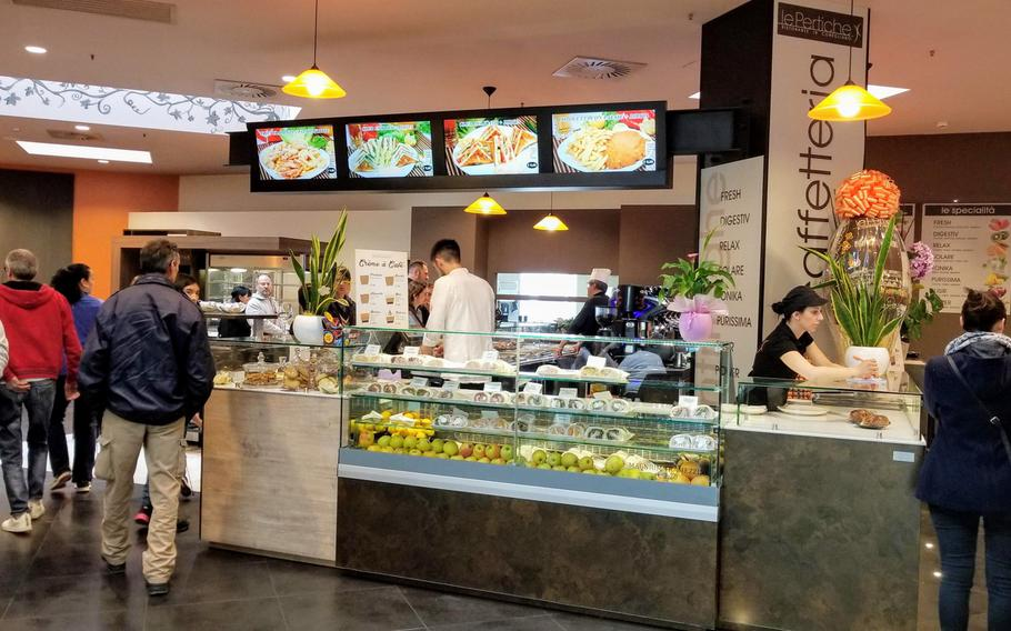 Le Pertiche is a small cafeteria-style restaurant and bar located inside the Cone Shopping Center in Conegliano, Italy. The shopping center is only a 30-minute drive away from Aviano Air Base, off route SS13.