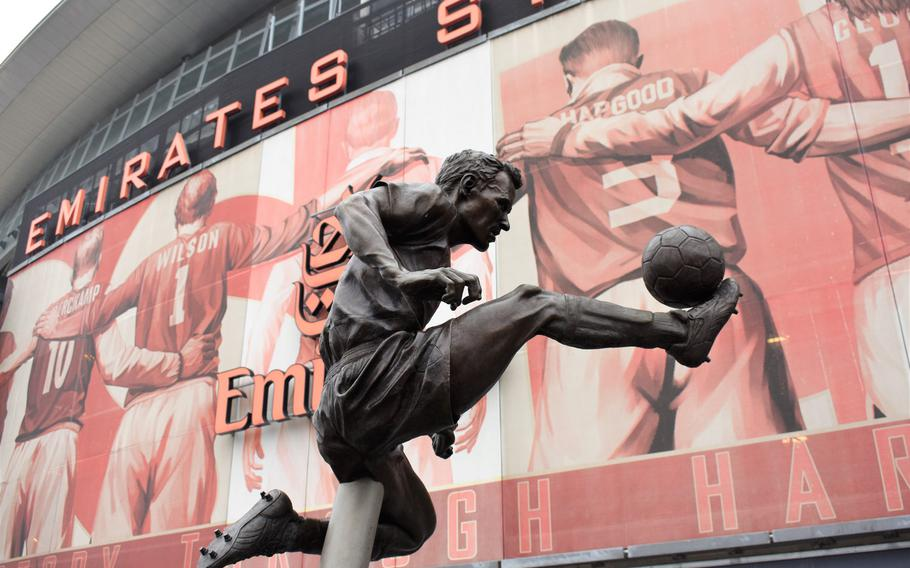 A statue of former Arsenal star Dennis Bergkamp is one of many such statues arranged around the soccer team's London home, Emirates Stadium.