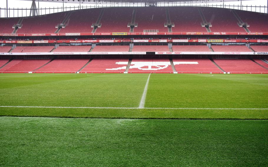The iconic cannon insignia of the Arsenal soccer team is painted into the lower bowl of Emirates Stadium in London. A tour of the stadium offers visitors a chance to sit in the field-level seats of the team's players and coaches.